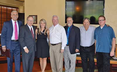 Valerie Barrett networks with members of the Orange County Stadium Club.