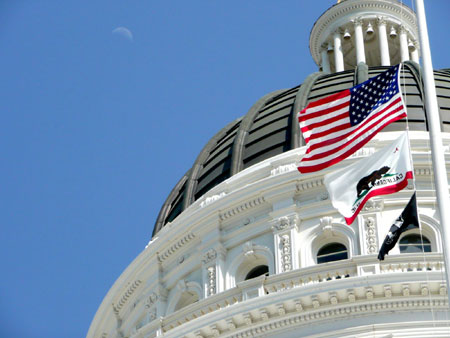 California Capitol building with CA and US flags