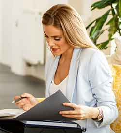 Blonde woman looking down at a folder
